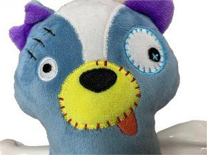 Speelgoed hond Scary stinkdier met been 17,5cm